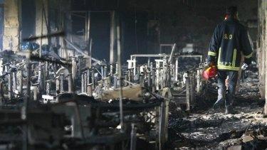 A firefighter inspects a garment factory after a blaze in Savar.