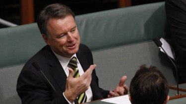 Joel Ftizgibbon takes his seat on the backbench during Question Time today after resigning as Defence Minister.