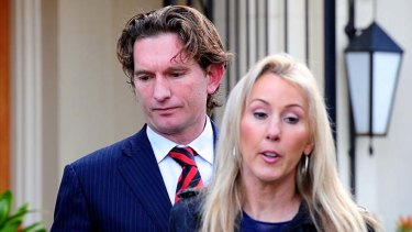 Big day: James Hird and wife Tania leave their Toorak home on Tuesday morning, heading for AFL House.