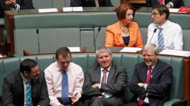 Kevin Rudd gets a laugh from his colleagues  as Julia Gillard and Climate Change Minister Greg Combet discuss parliamentary business.