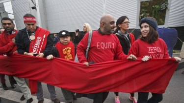 """Climate activists carry a red banner during a demonstration at the COP21, United Nations Climate Change Conference, in Le Bourget, north of Paris, Friday, Dec. 11, 2015. Hundreds of climate activists have stretched a block-long red banner through the Paris climate talks to symbolize """"the red lines"""" that they don't want negotiators to cross in trying to reach an international accord to fight global warming. (AP Photo/Michel Euler)"""