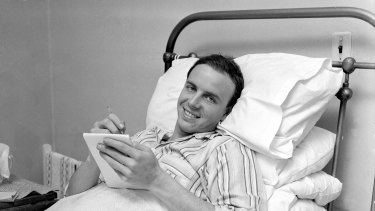 Singer: Johnny Rebb writes songs from his hospital bed in Sydney on 18 August 1962.