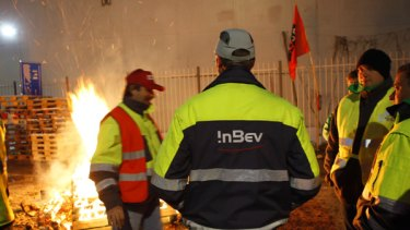Bosses taken hostage ... workers protest outside an Anheuser-Busch InBev plant in Leuven, Belgium.