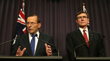 """""""Most difficult search in human history"""": Prime Minister Tony Abbott addresses the media with the chief of the Joint Agency Co-ordination Centre, Air Chief Marshal Angus Houston."""