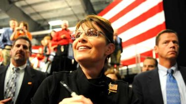 Republican vice-presidential candidate Sarah Palin greets supporters at a welcome home rally in Alaska.