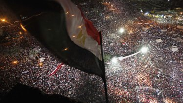 Anti-Mursi protesters chant slogans during a mass protest to support the army in Tahrir Square in Cairo.