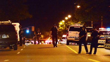 Two dead ... police stand on guard on Morningside Avenue.