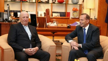King Harald V of Norway meets with Prime Minister Tony Abbott at Parliament House in Canberra on Monday.
