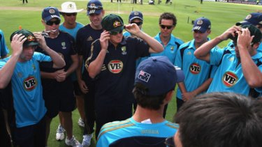 Debutants (L - R) Phil Hughes, Marcus North and Ben Hilfenhaus of Australia try on their baggy greens.