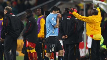 Luis Suarez leaves the pitch after his red card against Ghana.
