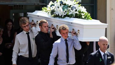 Katie Peters' coffin is carried out at the funeral of the young firefighter on Friday in Eskdale, north Victoria.