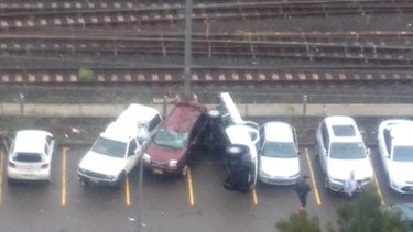 Cars overturned in a Hornsby car park after the storm cell went through.