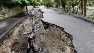 Damage done ... Tristan Webb stands in what's left of River Road, Avonside