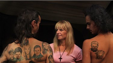 Peter Petkovski, left, with tattoos of sons Pauly and Ricky, his wife, Lena, sons Tony and Mark, sister Vera and brother Luke; Lena; and Ricky, with a tattoo of two of his brothers, Tony and Mark.
