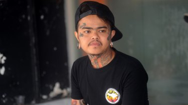 I Gede Agus Setiawan, an apprentice tattoo artist from Low Rider tattoo studio in Kuta