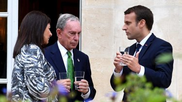 French President Emmanuel Macron, right, Paris mayor Anne Hidalgo, left, and former mayor of New York City Michael Bloomberg meet at the Elysee Palace in Paris on Friday.