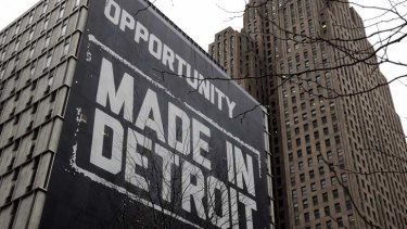 """A large """"Opportunity Made In Detroit"""" banner is seen on the side of a building in downtown Detroit, Michigan. The city has filed for bankruptcy."""