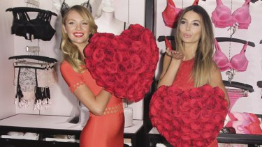 Models Candice Swanepoel and Lily Aldridge attend the Victoria's Secret Angels Celebrate Valentine's Day in New York.