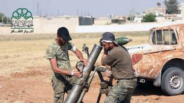 Rebel fighters from Ahrar al-Sham prepare an attack on Islamic State in Aleppo.