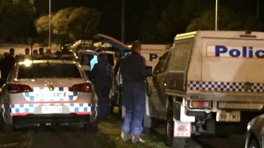 Forensic officers outside the home in Mt Gravatt-Capalaba Rd, Mackenzie, where a 10-year-old boy was found dead.