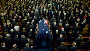 Malcolm Fraser's coffin is carried out of the church. Photo: Joe Armao