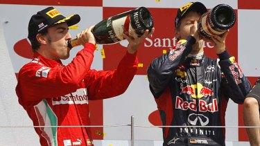 Drink up ... Fernando Alonso and Sebastian Vettel.