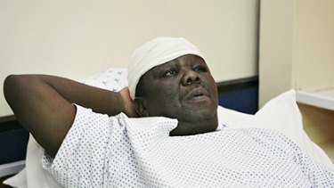 Zimbabwe's Prime Minister Morgan Tsvangirai lies in a hospital bed in Harare.