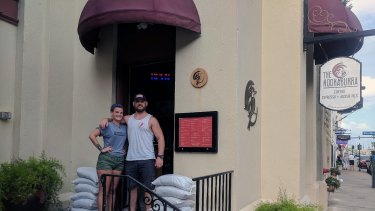 Spencer Hooker, co-owner of The Kookaburra Cafe, and staff member Kaitlin Bath, in St Augustine, Florida on Thursday