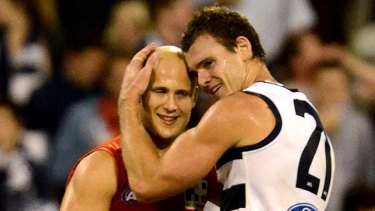 Suns Gary Ablett and Geelong's Cameron Mooney, May 28.