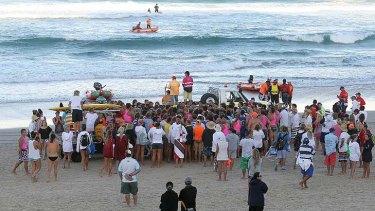 People gather on Kurrawa Beach.