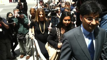 Lloyd Rayney, surrounded by media, outside the court.