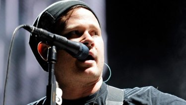 Blink-182 singer/guitarist Tom DeLonge denies quitting the band.