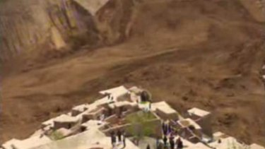 This image made from an AP video shows people searching for survivors after a massive landslide buried a village in Badakhshan province in north-eastern Afghanistan.