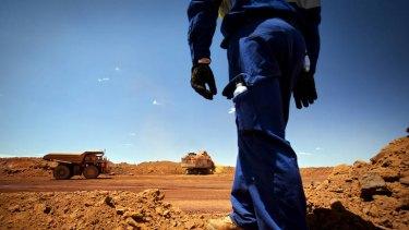 Diesel and dust … broken raw ore material is loaded into haul trucks at the Brockman 4 open-pit mine in WA's Pilbara region.