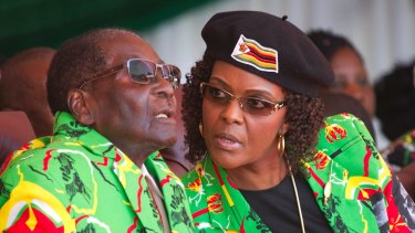 Zimbabwean President Robert Mugabe, left, and his wife Grace at a youth rally in June.
