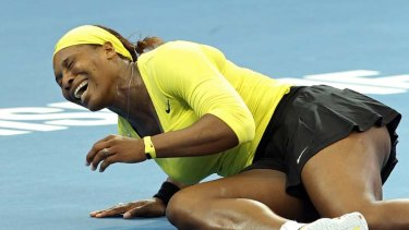 Pain … Serena Williams grimaces after twisting her ankle.