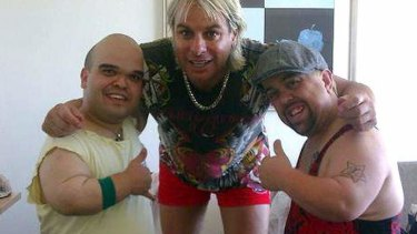 Set alight: Blake Johnston, right, former footballer Warwick Capper, centre, and a fellow 'Dwarf My Party' entertainer.