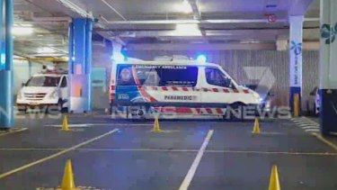 An ambulance leaves Fountain Gate shopping centre car park on March 27.