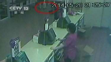 Security camera footage shows suspects attacking a woman (identified by red circle) at the McDonald's.