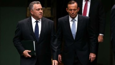 Big cuts: Treasurer Joe Hockey and Prime Minister Tony Abbott arrive to hand down the budget in the House of Representatives.