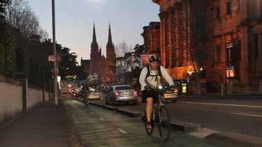 Fast lane ... riders make use of the separated cycleway along College Street.