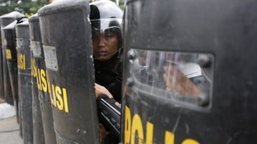 Brief skirmish: Indonesian police outside the Constitutional Court on Thursday.