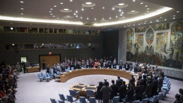 Members of the UN Security Council stand for a moment of silence.