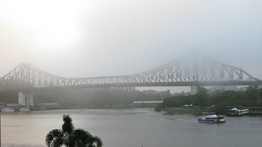 Heavy fog blankets Brisbane's Story Bridge this morning.