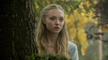 What big eyes you have: Amanda Seyfried flashes those famous peepers in the dour Red Riding Hood.