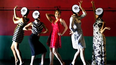 Stepping out: Sweet Charity performers Verity Hunt-Ballard (red dress) with, from left, Stephanie Grigg, Kirby Burgess, Lisa Sontag and Rowena Vilar.