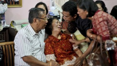 Distraught relatives of one of the passengers wait for news.