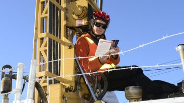 Protestor Tony Murphy, chained to a drilling rig in Carlton North.