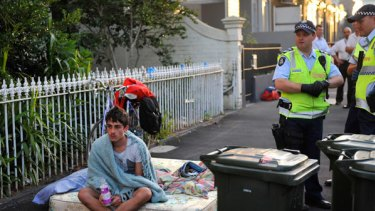 One of the squatters on the footpath outside the Faraday Street terraces after this morning's eviction.