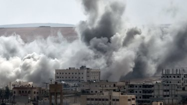 Smoke rises from an air strike on the southwestern part of the Syrian town of Kobane. The coalition continues air strikes on IS targets in Kobane.